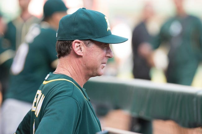 Jul 25, 2014; Arlington, TX, USA; Oakland Athletics manager Bob Melvin (6) before the game against the Texas Rangers at Globe Life Park in Arlington. The Rangers defeated the Athletics 4-1. Mandatory Credit: Jerome Miron-USA TODAY Sports