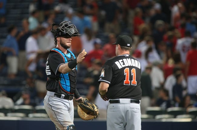 Jul 24, 2014; Atlanta, GA, USA; Miami Marlins catcher Jarrod Saltalamacchia (39) celebrates their 3-2 win over the Atlanta Braves with Miami Marlins manager Mike Redmond (11) at Turner Field. Mandatory Credit: Jason Getz-USA TODAY Sports
