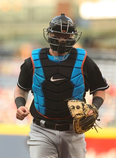 Jul 24, 2014; Atlanta, GA, USA; Miami Marlins catcher Jarrod Saltalamacchia (39) walks back to home plate after meeting with Miami Marlins starting pitcher Henderson Alvarez (not pictured) in the first inning of their game against the Atlanta Braves at Turner Field. Marlins won 3-2. Mandatory Credit: Jason Getz-USA TODAY Sports
