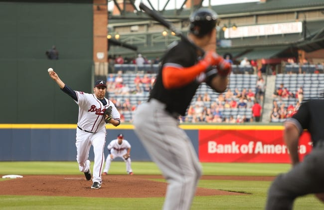Jul 24, 2014; Atlanta, GA, USA; Atlanta Braves starting pitcher Aaron Harang (34) delivers a pitch to Miami Marlins right fielder Giancarlo Stanton (27) in the first inning of their game at Turner Field. Marlins won 3-2. Mandatory Credit: Jason Getz-USA TODAY Sports