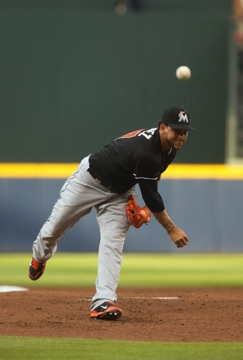 Jul 24, 2014; Atlanta, GA, USA; Miami Marlins starting pitcher Henderson Alvarez (37) delivers a pitch to an Atlanta Braves batter in the first inning of their game at Turner Field. Marlins won 3-2. Mandatory Credit: Jason Getz-USA TODAY Sports