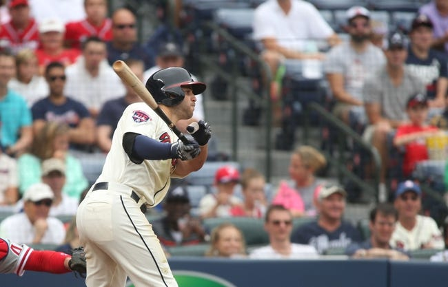 Jul 20, 2014; Atlanta, GA, USA; Atlanta Braves second baseman Tommy La Stella (7) hits a three-run double in the third inning of their game against the Philadelphia Phillies at Turner Field. The Braves won 8-2. Mandatory Credit: Jason Getz-USA TODAY Sports