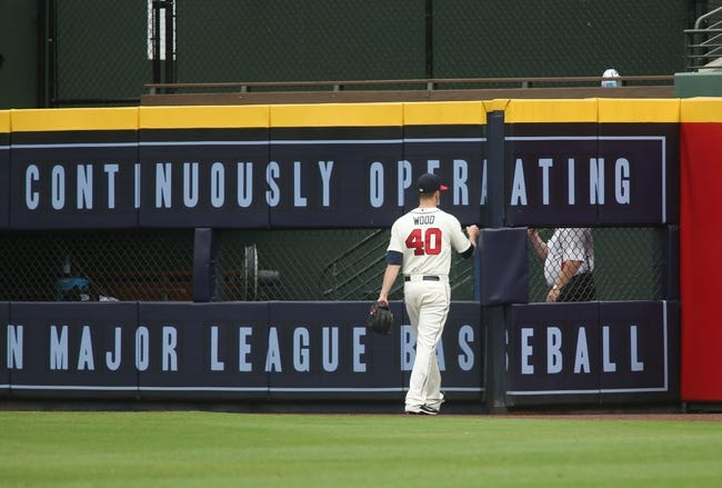 Jul 20, 2014; Atlanta, GA, USA; Atlanta Braves starting pitcher Alex Wood (40) walks to the bullpen before his game starting against the Philadelphia Phillies batter in the first inning of their game at Turner Field. The Braves won 8-2. Mandatory Credit: Jason Getz-USA TODAY Sports