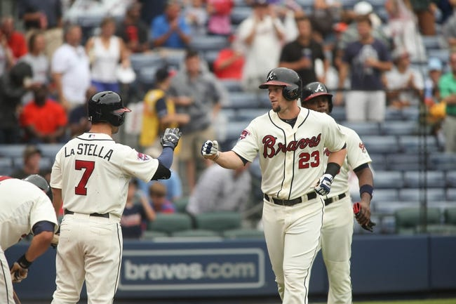 Jul 20, 2014; Atlanta, GA, USA; Atlanta Braves third baseman Chris Johnson (23) celebrates his two-run home run off of Philadelphia Phillies starting pitcher Kyle Kendrick (not pictured) with Atlanta Braves second baseman Tommy La Stella (7) in the second inning of their game at Turner Field. The Braves won 8-2. Mandatory Credit: Jason Getz-USA TODAY Sports