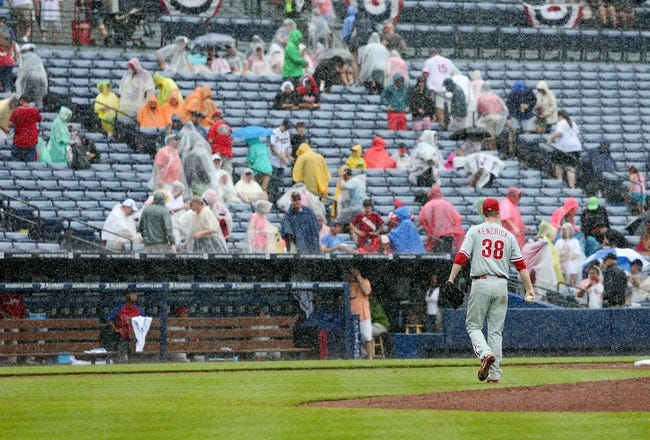 Jul 20, 2014; Atlanta, GA, USA; Philadelphia Phillies starting pitcher Kyle Kendrick (38) walks to the dugout during a rain delay in the 6th inning of their game against the Atlanta Braves at Turner Field. The Braves won 8-2. Mandatory Credit: Jason Getz-USA TODAY Sports