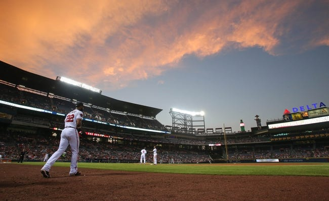 Jul 24, 2014; Atlanta, GA, USA; Atlanta Braves right fielder Jason Heyward (22) walks onto the field before the start of the eighth inning as the sun sets in their game against the Miami Marlins at Turner Field. Marlins won 3-2. Mandatory Credit: Jason Getz-USA TODAY Sports