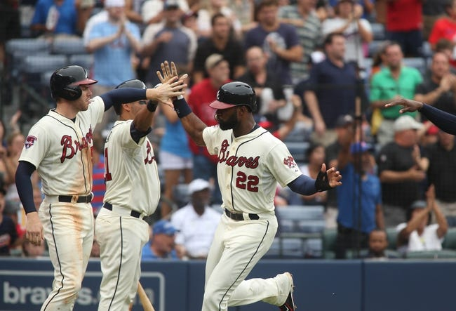 Jul 20, 2014; Atlanta, GA, USA; Atlanta Braves right fielder Jason Heyward (22) celebrates a run with Atlanta Braves first baseman Freddie Freeman (5, left) and Atlanta Braves catcher Gerald Laird (11) on a double by Atlanta Braves second baseman Tommy La Stella (not pictured) in the third inning of their game against the Philadelphia Phillies at Turner Field. The Braves won 8-2. Mandatory Credit: Jason Getz-USA TODAY Sports