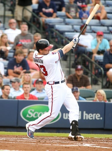 Jul 24, 2014; Atlanta, GA, USA; Atlanta Braves third baseman Chris Johnson (23) hits a two-run home run off of Miami Marlins starting pitcher Henderson Alvarez (not pictured) in the second inning of their game at Turner Field. Marlins won 3-2. Mandatory Credit: Jason Getz-USA TODAY Sports