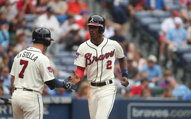 Jul 20, 2014; Atlanta, GA, USA; Atlanta Braves center fielder B.J. Upton (2) celebrates a score with Atlanta Braves second baseman Tommy La Stella (7) off a bases-loaded walk of Atlanta Braves right fielder Jason Heyward (not pictured) in the third inning of their game against the Philadelphia Phillies at Turner Field. The Braves won 8-2. Mandatory Credit: Jason Getz-USA TODAY Sports