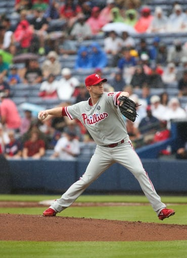 Jul 20, 2014; Atlanta, GA, USA; Philadelphia Phillies starting pitcher Kyle Kendrick (38) delivers a pitch in the first inning of their game against the Atlanta Braves at Turner Field. The Braves won 8-2. Mandatory Credit: Jason Getz-USA TODAY Sports