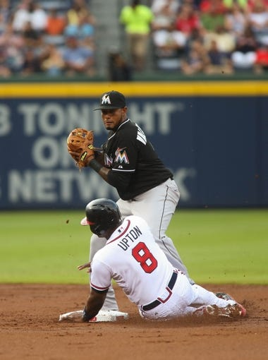 Jul 24, 2014; Atlanta, GA, USA; Atlanta Braves left fielder Justin Upton (8) breaks up a double play attempt by Miami Marlins second baseman Jordany Valdespin (1) on a hit by Atlanta Braves right fielder Jason Heyward (not pictured) in the second inning of their game at Turner Field. Marlins won 3-2. Mandatory Credit: Jason Getz-USA TODAY Sports