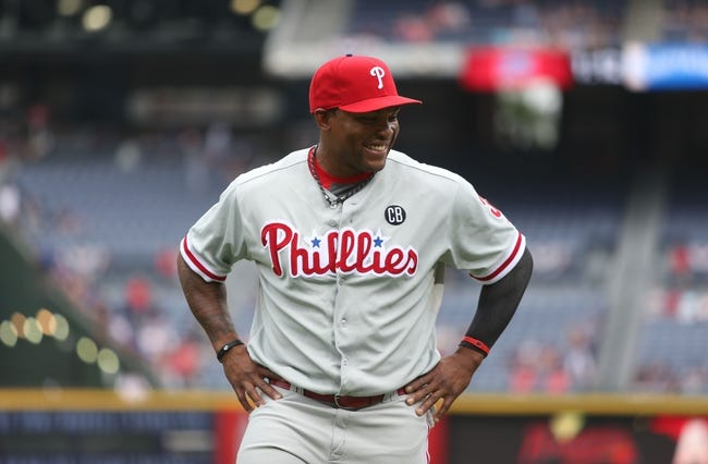 Jul 20, 2014; Atlanta, GA, USA; Philadelphia Phillies right fielder Marlon Byrd (3) talks with teammates before their game against the Atlanta Braves at Turner Field. The Braves won 8-2. Mandatory Credit: Jason Getz-USA TODAY Sports