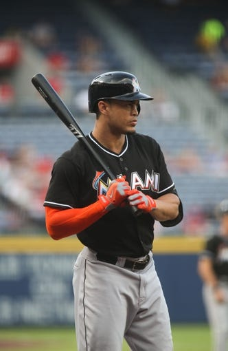 Jul 24, 2014; Atlanta, GA, USA; Miami Marlins right fielder Giancarlo Stanton (27) warms up before facing Atlanta Braves starting pitcher Aaron Harang (not pictured) in the first inning of their game at Turner Field. Marlins won 3-2. Mandatory Credit: Jason Getz-USA TODAY Sports