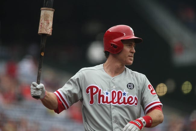 Jul 20, 2014; Atlanta, GA, USA; Philadelphia Phillies second baseman Chase Utley (26) warms up before he takes his first at bat against Atlanta Braves starting pitcher Alex Wood (not pictured) in the first inning of their game at Turner Field. The Braves won 8-2. Mandatory Credit: Jason Getz-USA TODAY Sports