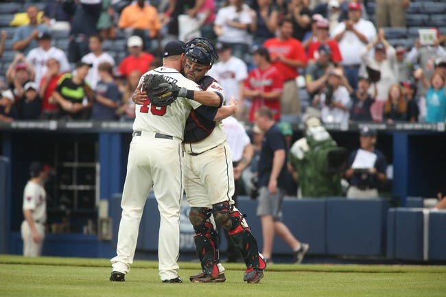 Jul 20, 2014; Atlanta, GA, USA; Atlanta Braves relief pitcher David Carpenter (48) celebrates their 8-2 win over the Philadelphia Phillies with Atlanta Braves catcher Gerald Laird (11) at Turner Field. Mandatory Credit: Jason Getz-USA TODAY Sports