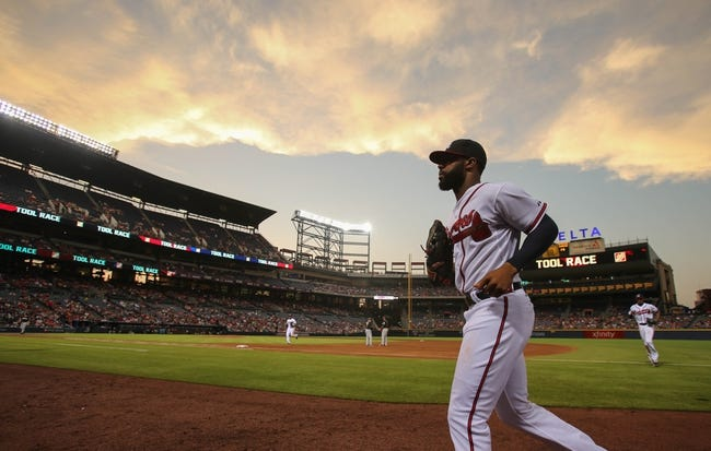Jul 24, 2014; Atlanta, GA, USA; Atlanta Braves right fielder Jason Heyward (22) returns to the dugout after playing defense in the seventh inning in their game against the Miami Marlins at Turner Field. Marlins won 3-2. Mandatory Credit: Jason Getz-USA TODAY Sports