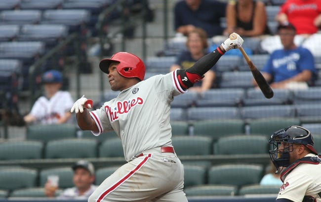 Jul 20, 2014; Atlanta, GA, USA; Philadelphia Phillies right fielder Marlon Byrd (3) hits a solo home run in the ninth inning of their game against the Atlanta Braves at Turner Field. The Braves won 8-2. Mandatory Credit: Jason Getz-USA TODAY Sports