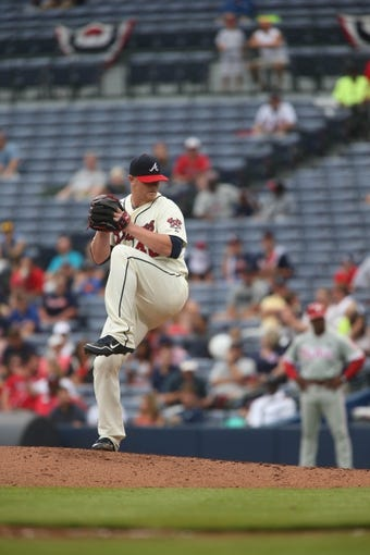 Jul 20, 2014; Atlanta, GA, USA; Atlanta Braves relief pitcher David Carpenter (48) delivers a pitch in the ninth inning of their game against the Philadelphia Phillies at Turner Field. The Braves won 8-2. Mandatory Credit: Jason Getz-USA TODAY Sports