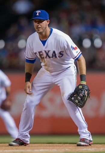 Jul 25, 2014; Arlington, TX, USA; Texas Rangers first baseman J.P. Arencibia (7) during the game against the Oakland Athletics at Globe Life Park in Arlington. The Rangers defeated the Athletics 4-1. Mandatory Credit: Jerome Miron-USA TODAY Sports