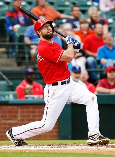 Apr 19, 2014; Arlington, TX, USA; Texas Rangers third baseman Kevin Kouzmanoff (6) bats during the game against the Chicago White Sox at Globe Life Park in Arlington. Texas won 6-3. Mandatory Credit: Kevin Jairaj-USA TODAY Sports