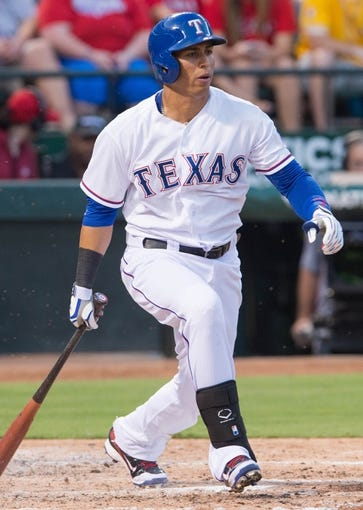 Jul 25, 2014; Arlington, TX, USA; Texas Rangers center fielder Leonys Martin (2) bats during the game against the Oakland Athletics at Globe Life Park in Arlington. The Rangers defeated the Athletics 4-1. Mandatory Credit: Jerome Miron-USA TODAY Sports