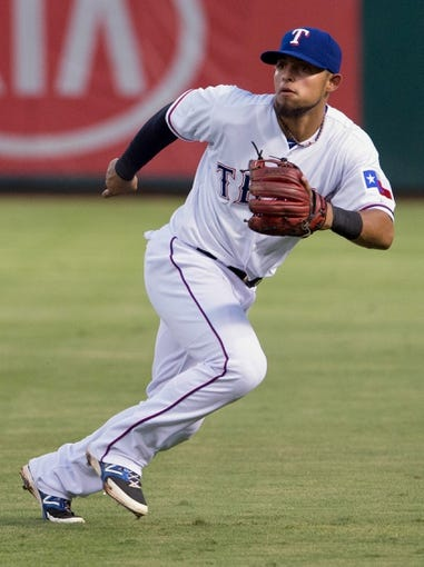 Jul 25, 2014; Arlington, TX, USA; Texas Rangers second baseman Rougned Odor (12) during the game against the Oakland Athletics at Globe Life Park in Arlington. The Rangers defeated the Athletics 4-1. Mandatory Credit: Jerome Miron-USA TODAY Sports