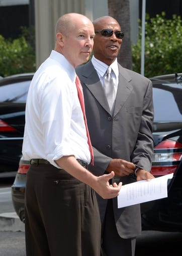 Jul 29, 2014; El Segundo, CA, USA; Los Angeles Lakers vice president of public relations John Black (left) and Byron Scott before a press conference to announce Scott as coach at Toyota Sports Center. Mandatory Credit: Kirby Lee-USA TODAY Sports