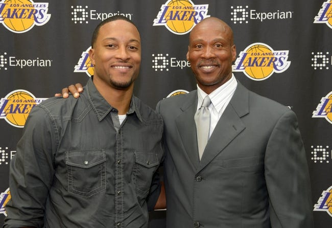 Jul 29, 2014; El Segundo, CA, USA; Byron Scott (right) poses with son Thomas Scott at a press conference to announce his hiring as Los Angeles Lakers coach at Toyota Sports Center. Mandatory Credit: Kirby Lee-USA TODAY Sports