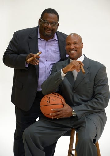 Jul 29, 2014; El Segundo, CA, USA; Byron Scott (right) poses with sports agent Emanuel Hudson at press conference to announce his hiring as Los Angeles Lakers coach at Toyota Sports Center. Mandatory Credit: Kirby Lee-USA TODAY Sports