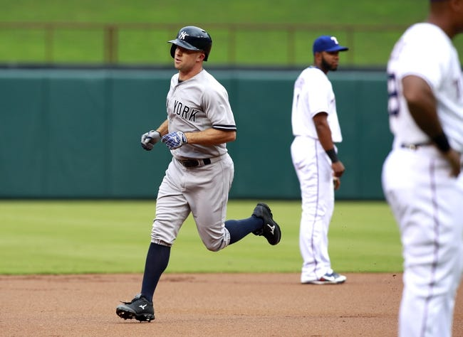 Jul 29, 2014; Arlington, TX, USA; New York Yankees left fielder Brett Gardner (11) rounds the bases after hitting a home run in the first inning against the Texas Rangers at Globe Life Park in Arlington. Mandatory Credit: Tim Heitman-USA TODAY Sports
