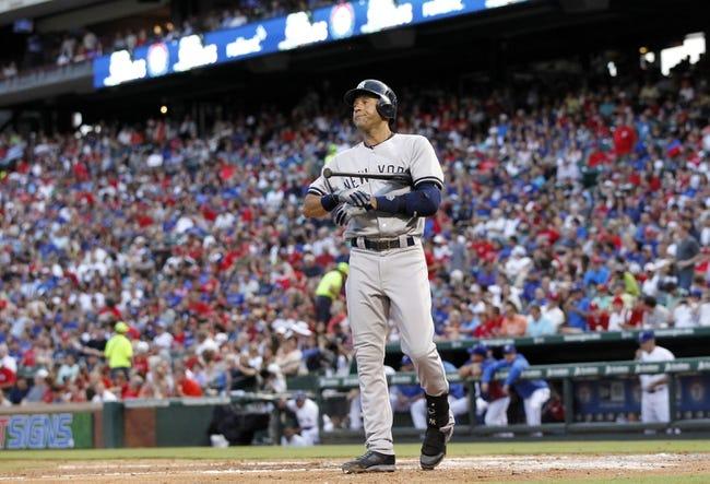 Jul 29, 2014; Arlington, TX, USA; New York Yankees shortstop Derek Jeter (2) in game action in the third inning against the Texas Rangers  at Globe Life Park in Arlington. Mandatory Credit: Tim Heitman-USA TODAY Sports