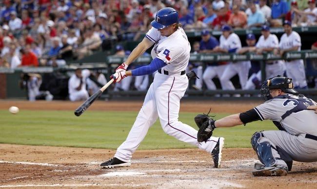 Jul 29, 2014; Arlington, TX, USA; Texas Rangers designated hitter Jim Adduci (35) singles in a run in the third inning against the New York Yankees at Globe Life Park in Arlington. Mandatory Credit: Tim Heitman-USA TODAY Sports