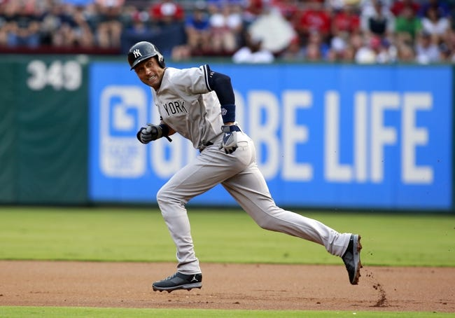 Jul 29, 2014; Arlington, TX, USA; New York Yankees shortstop Derek Jeter (2) runs towards second base on a full count pitch in the first inning against the Texas Rangers at Globe Life Park in Arlington. Mandatory Credit: Tim Heitman-USA TODAY Sports