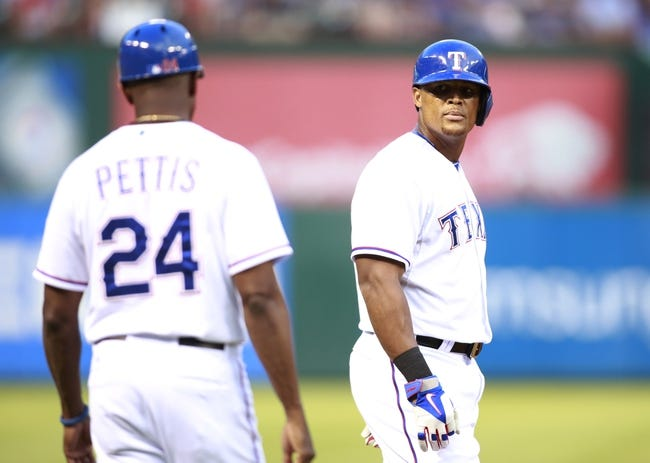 Jul 29, 2014; Arlington, TX, USA; Texas Rangers third baseman Adrian Beltre (29) looks to third base coach Gary Pettis (24) after reaching third base on a wild pitch by New York Yankees starting pitcher Brandon McCarthy (not pictured) in the third inning at Globe Life Park in Arlington. Mandatory Credit: Tim Heitman-USA TODAY Sports