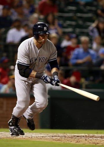 Jul 29, 2014; Arlington, TX, USA; New York Yankees designated hitter Carlos Beltran (36) hits a two run single in the sixth inning against the Texas Rangers at Globe Life Park in Arlington. Mandatory Credit: Tim Heitman-USA TODAY Sports