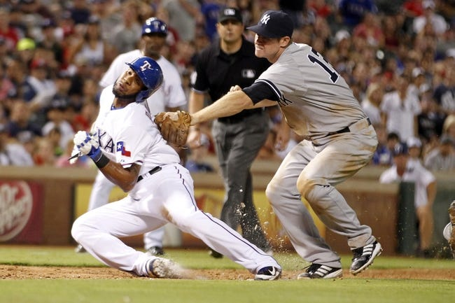 Jul 29, 2014; Arlington, TX, USA; Texas Rangers shortstop Elvis Andrus (1) is tagged out by New York Yankees third baseman Chase Headley (12) in the seventh inning at Globe Life Park in Arlington. New York beat Texas 12-11. Mandatory Credit: Tim Heitman-USA TODAY Sports