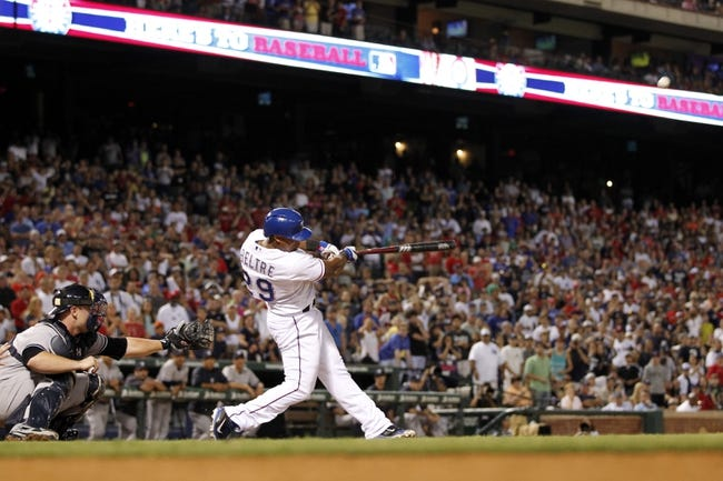 Jul 29, 2014; Arlington, TX, USA; Texas Rangers third baseman Adrian Beltre (29) flies out with the bases loaded in the ninth inning against the New York Yankees at Globe Life Park in Arlington.  New York beat Texas 12-11. Mandatory Credit: Tim Heitman-USA TODAY Sports