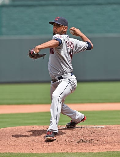 Jul 27, 2014; Kansas City, MO, USA; Cleveland Indians pitcher Danny Salazar (31) delivers a warm up pitch against the Kansas City Royals during the first inning at Kauffman Stadium. Mandatory Credit: Peter G. Aiken-USA TODAY Sports