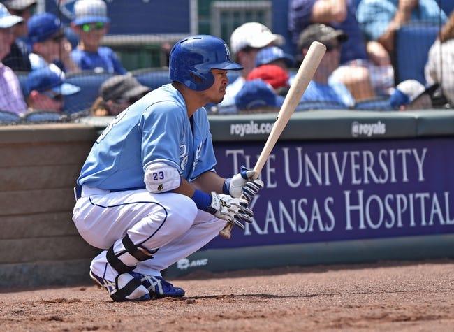 Jul 27, 2014; Kansas City, MO, USA; Kansas City Royals right fielder Nori Aoki (23) on deck against the Cleveland Indians during the fifth inning at Kauffman Stadium. Mandatory Credit: Peter G. Aiken-USA TODAY Sports