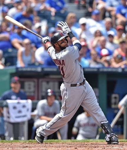 Jul 27, 2014; Kansas City, MO, USA; Cleveland Indians first basemen Carlos Santana (41) hits a two run home run against the Kansas City Royals during the fifth inning at Kauffman Stadium. Mandatory Credit: Peter G. Aiken-USA TODAY Sports