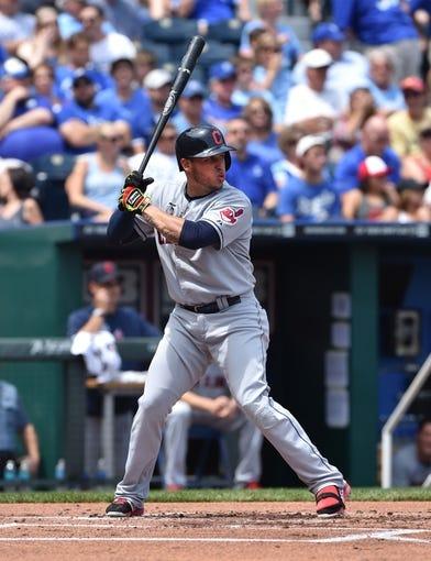 Jul 27, 2014; Kansas City, MO, USA; Cleveland Indians shortstop Asdrubal Cabrera (13) at bat against the Kansas City Royals during the first inning at Kauffman Stadium. Mandatory Credit: Peter G. Aiken-USA TODAY Sports