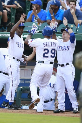 Jul 30, 2014; Arlington, TX, USA; Texas Rangers manager Ron Washington (38) and left fielder Daniel Robertson (19) congratulate third baseman Adrian Beltre (29) after he scored a run in the first inning against the New York Yankees at Globe Life Park in Arlington. Mandatory Credit: Tim Heitman-USA TODAY Sports