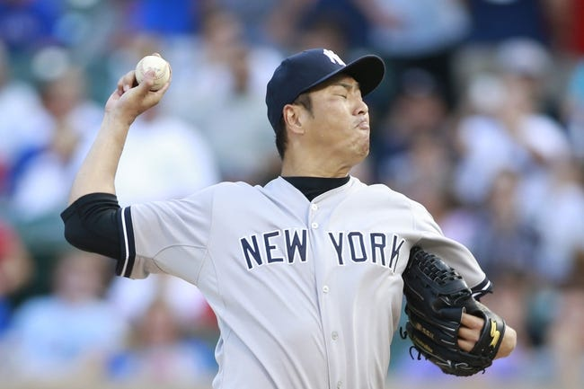 Jul 30, 2014; Arlington, TX, USA; New York Yankees starting pitcher Hiroki Kuroda (18) throws a pitch in the first inning against the Texas Rangers at Globe Life Park in Arlington. Mandatory Credit: Tim Heitman-USA TODAY Sports