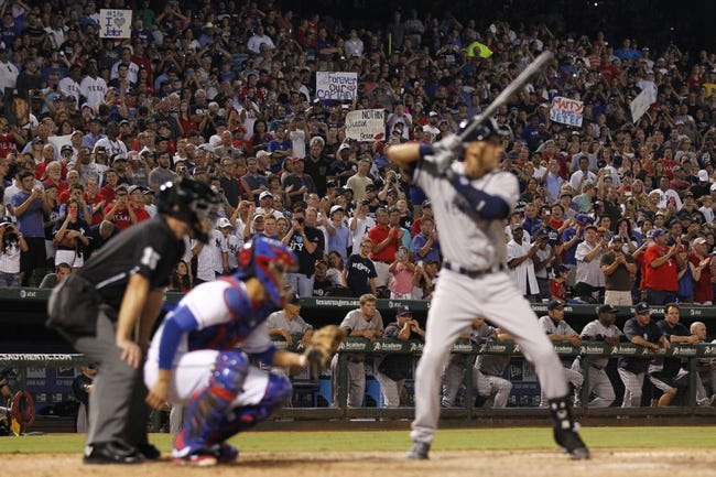 Jul 30, 2014; Arlington, TX, USA; Fans hold up signs during New York Yankees shortstop Derek Jeter (2) last at bat against the Texas Rangers at Globe Life Park in Arlington.  Texas beat New York 3-2. Mandatory Credit: Tim Heitman-USA TODAY Sports