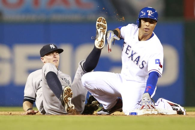 Jul 30, 2014; Arlington, TX, USA;Texas Rangers center fielder Leonys Martin (2) steals second base and avoids the tag of New York Yankees second baseman Brendan Ryan (17) in the eighth inning  at Globe Life Park in Arlington.  Texas beat New York 3-2. Mandatory Credit: Tim Heitman-USA TODAY Sports