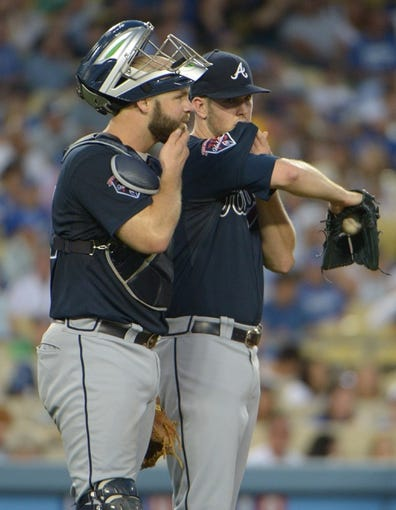 Jul 30, 2014; Los Angeles, CA, USA; Atlanta Braves pitcher Alex Wood (right) and catcher Evan Gattis react during the game against the Los Angeles Dodgers at Dodger Stadium. Mandatory Credit: Kirby Lee-USA TODAY Sports