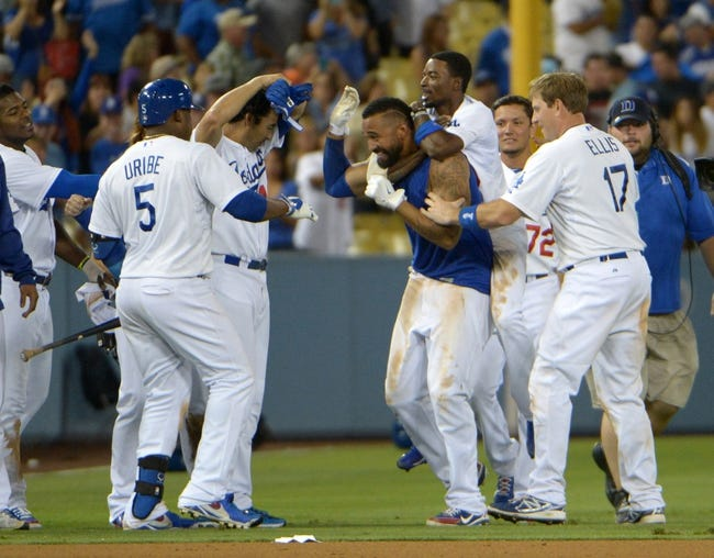 Jul 30, 2014; Los Angeles, CA, USA; Los Angeles Dodgers right fielder Matt Kemp (27) celebrates with teammates Juan Uribe (5), Andre Ethier (16), Dee Gordon (9), Miguel Rojas (72) and A.J. Ellis (17) after a hitting a walk-off single in the 10th inning against the Atlanta Braves at Dodger Stadium. The Dodgers defeated the Braves 2-1 in 10 innings. Mandatory Credit: Kirby Lee-USA TODAY Sports