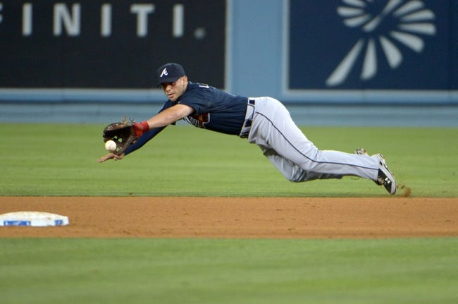 Jul 30, 2014; Los Angeles, CA, USA; Atlanta Braves second baseman Tommy La Stella fields a ground ball by Los Angeles Dodgers second baseman Dee Gordon (not pictured) in the fifth inning at Dodger Stadium. The Dodgers defeated the Braves 2-1 in 10 innings. Mandatory Credit: Kirby Lee-USA TODAY Sports