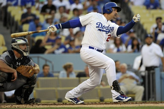Jul 31, 2014; Los Angeles, CA, USA; Los Angeles Dodgers first baseman Adrian Gonzalez (23) doubles in the 1st inning against the Atlanta Braves driving in teammate Yasiel Puig (not pictured) at Dodger Stadium. Mandatory Credit: Robert Hanashiro-USA TODAY Sports