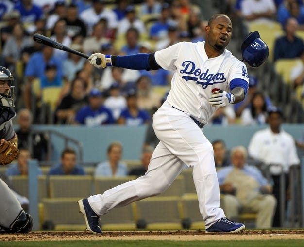 Jul 31, 2014; Los Angeles, CA, USA; Los Angeles Dodgers left fielder Carl Crawford (3) loses his helmet while striking out against the Atlanta Braves starting pitcher Julio Teheran (49) in the 1st inning at Dodger Stadium. Mandatory Credit: Robert Hanashiro-USA TODAY Sports